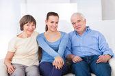 Happy Caregiver With Senior Couple — Stock Photo