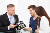 Businessman Showing House Picture To Couple On Tablet — Stock Photo