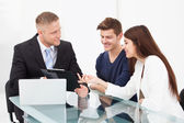 Couple Discussing With Financial Advisor — Stock Photo