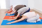 People Performing Yoga At Gym — Foto de Stock