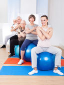 Trainer And Senior Customers Sitting On Fitness Balls — Foto Stock
