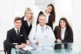 Doctor And Businesspeople Using Laptop — Stock Photo