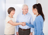 Caregiver Shaking Hands With Senior Couple — Stock Photo