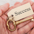Man Holding Key With Success Tag — Stock Photo