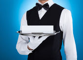 Waiter Carrying Silver Tray With Blank Card — Stock Photo