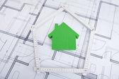 House In Folding Ruler On Blueprint — Stock Photo