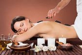 Woman Receiving Hot Stone Therapy In Spa — Stock Photo