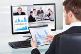 Businessman Video Conferencing With Colleagues — Stock Photo