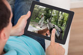 Man Playing Action Game On Digital Tablet — Stockfoto