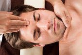 Young Man Receiving Forehead Massage — Stock Photo