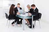 Businesspeople Working At Desk — Stock Photo