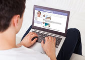 Man Using Social Networking Site On Laptop — Stock Photo