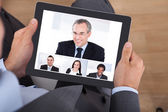 Businessman Video Conferencing With Coworkers — Stock Photo