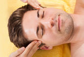 Relaxed Man Receiving Forehead Massage In Spa — Stock Photo