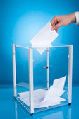 Businessman Putting Paper In Election Box — Stockfoto