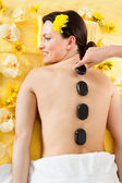 Woman Receiving Hot Stone Therapy In Spa — Stockfoto