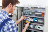 Technician Examining Fusebox — Stock Photo