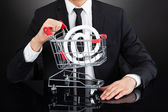 Businessman With Shopping Cart Model — Stock Photo