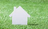 House Model In Grassy Field — Stock Photo