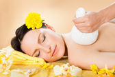 Woman Receiving Massage With Herbal Compress Stamps At Spa — Stock Photo