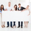 Confident Businesspeople with Blank Banner — Stock Photo