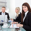 Businesswoman Sitting With Colleagues In Meeting — Stock Photo #47346851