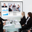 Businesspeople Looking At Projector Screen — Stock Photo #47347129
