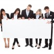 Confident Businesspeople with Blank Banner — Stock Photo #47347651