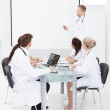 Doctor Giving Presentation To Colleagues — Stock Photo #47348005