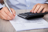Businessman Calculating Financial Expenses — Stock Photo