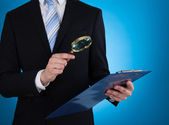 Businessman and Magnifying Glass — Stock Photo