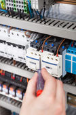 Electrician Examining Fusebox — Stock Photo