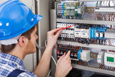 Technician Examining Fusebox — Stock Photo