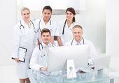Confident Doctors At Desk — Foto de Stock