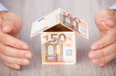 Businessman Hands with Euro House — Stock Photo