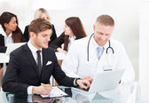 Doctor And Businessman with Laptop — Foto Stock