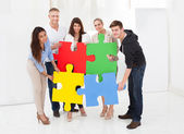 Businesspeople Joining Puzzle Pieces — Stock Photo