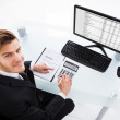 Businessman Calculating Expenses At Office Desk — Stock Photo #47763153