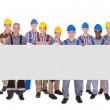 Multiethnic Manual Workers Holding Blank Banner — Stock Photo #47763209