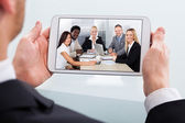 Businessman Video Conferencing On Digital Tablet At Desk — Stock Photo