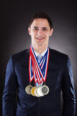 Smiling Businessman Wearing Medals — Stock Photo