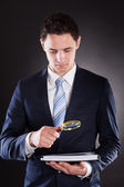 Businessman Analyzing Documents With Magnifying Glass — Stock Photo