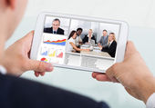 Businessman Video Conferencing With Team On Digital Tablet — Stock Photo