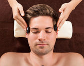 Handsome Man Receiving Hot Stone Therapy In Spa — Stock Photo