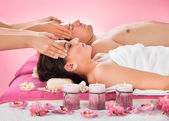 Relaxed Couple Receiving Head Massage At Spa — Stock Photo
