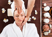 Young Woman Receiving Head Massage At Spa — Stock Photo