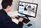 Businessman Video Conferencing With Team In Office — Stock Photo