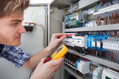Technician Examining Fusebox With Insulation Resistance Tester — Stock Photo