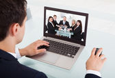 Businessman Video Conferencing On Laptop In Office — Stock Photo