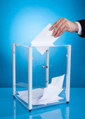 Businessman Putting Paper In Polling Box — Stock Photo